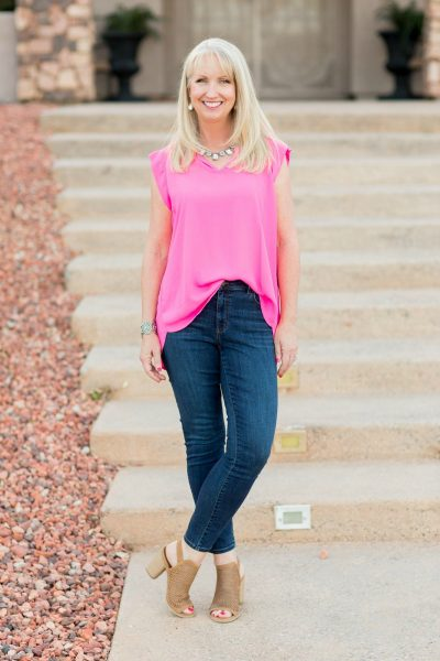 Skinny jeans paired with a flirty pink top