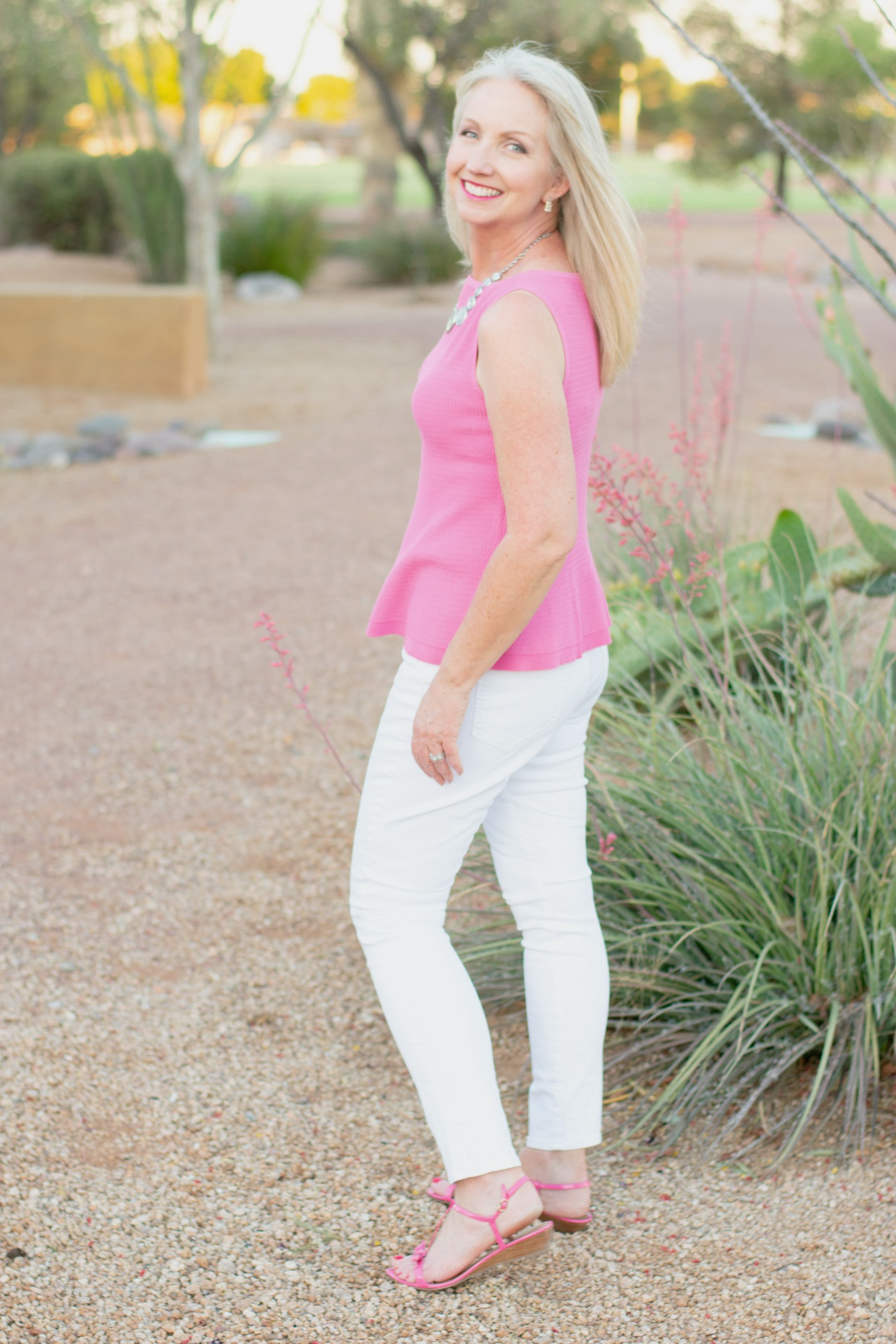 White skinny jeans with pink sleeveless top
