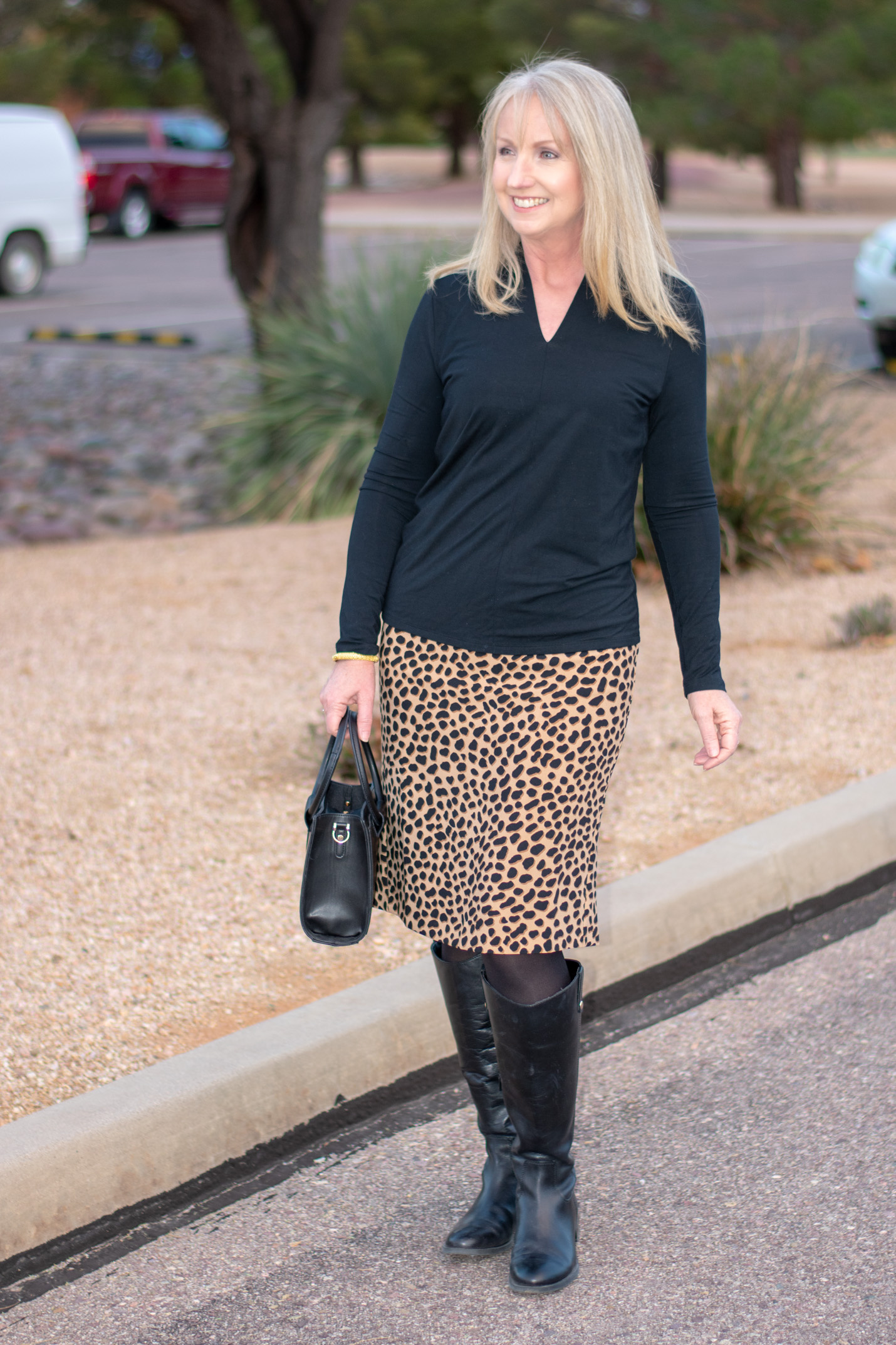 black riding boots with a print skirt