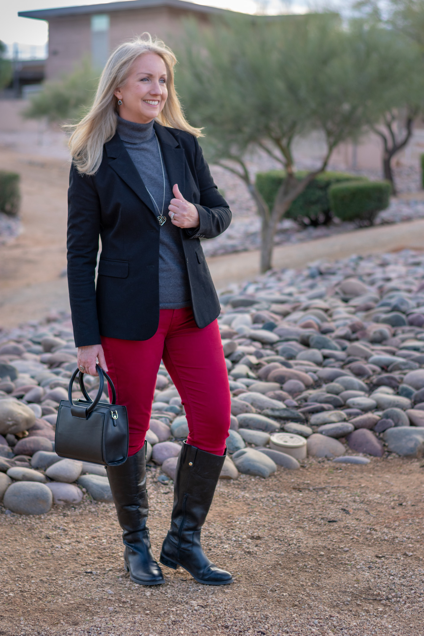 black riding boots with colored jeans
