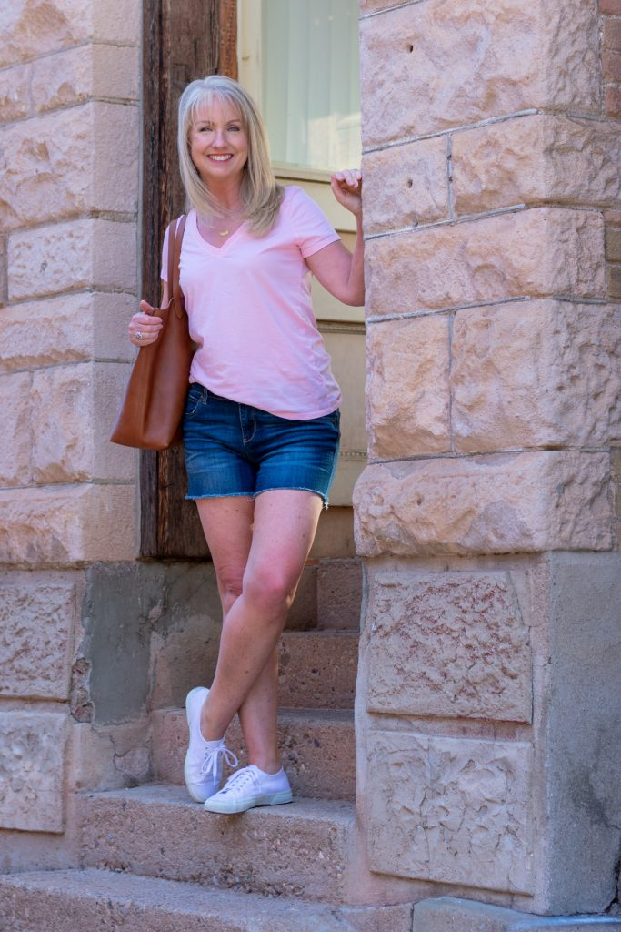 Wearing sneakers with denim shorts