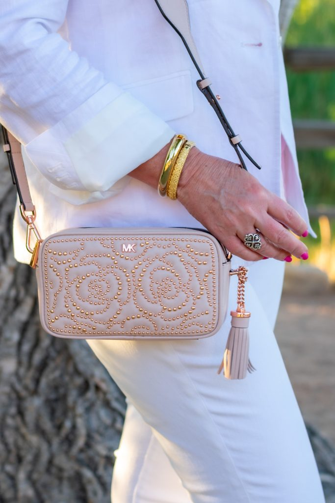 rose studded camera bag