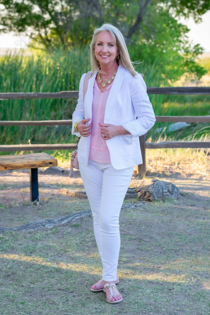 white blazer with white jeans and soft pink tee