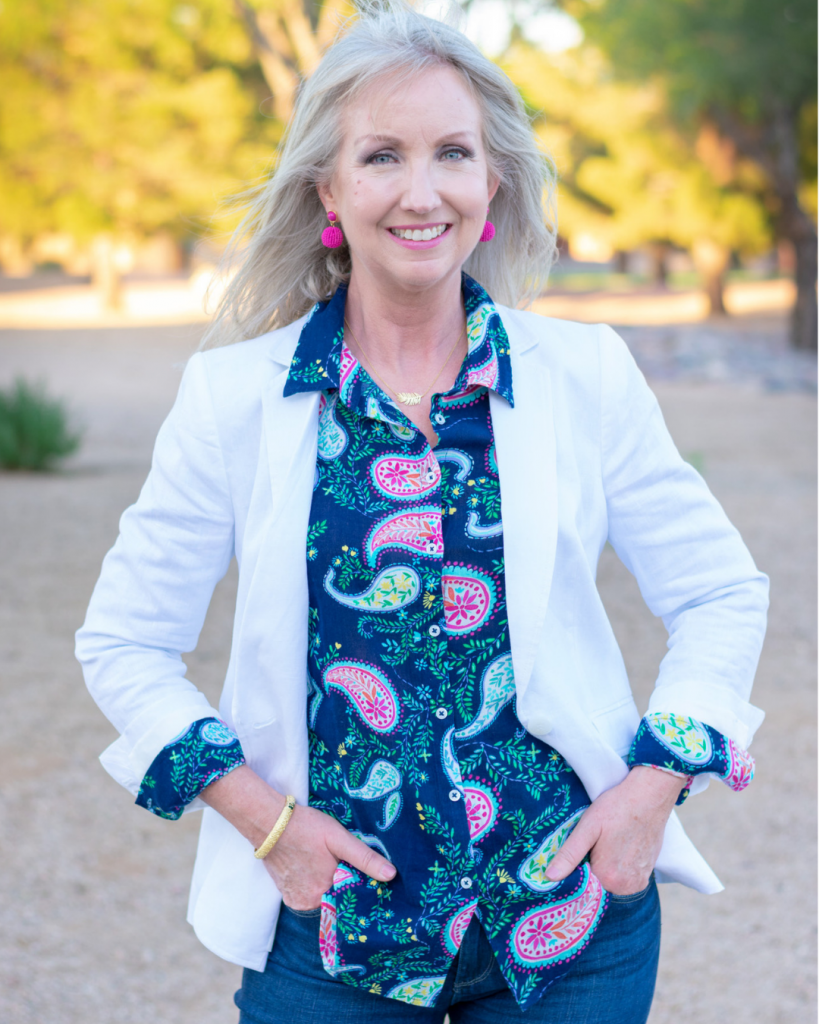 white blazer with colorful print shirt and rolled cuffs