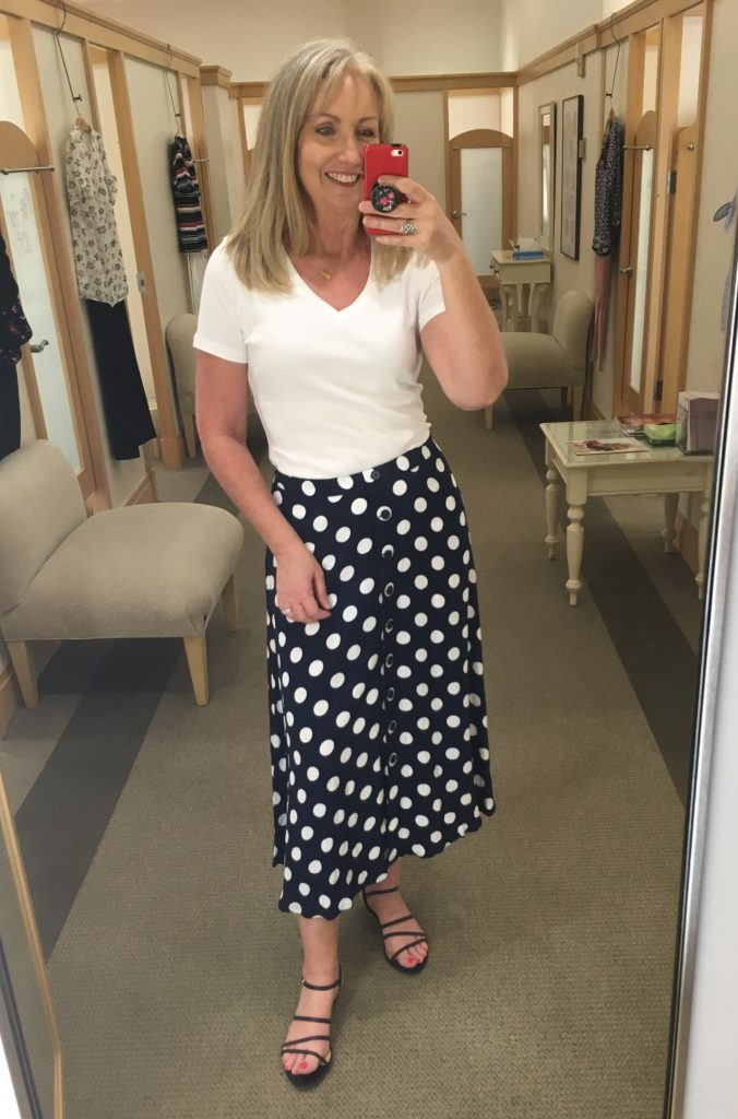 white v-neck tee with dotty midi skirt