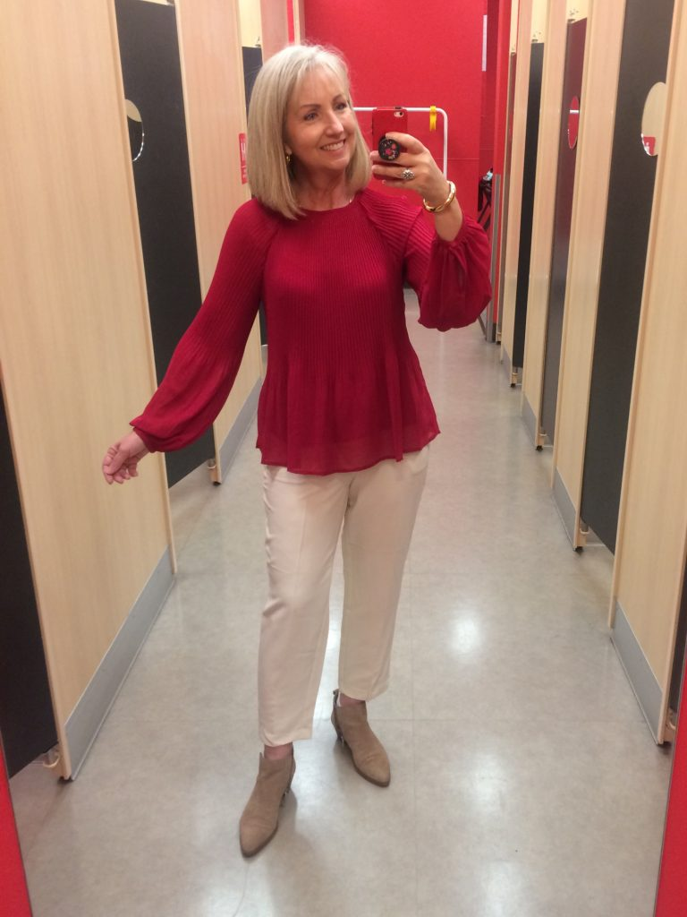 White pants and red pleated top