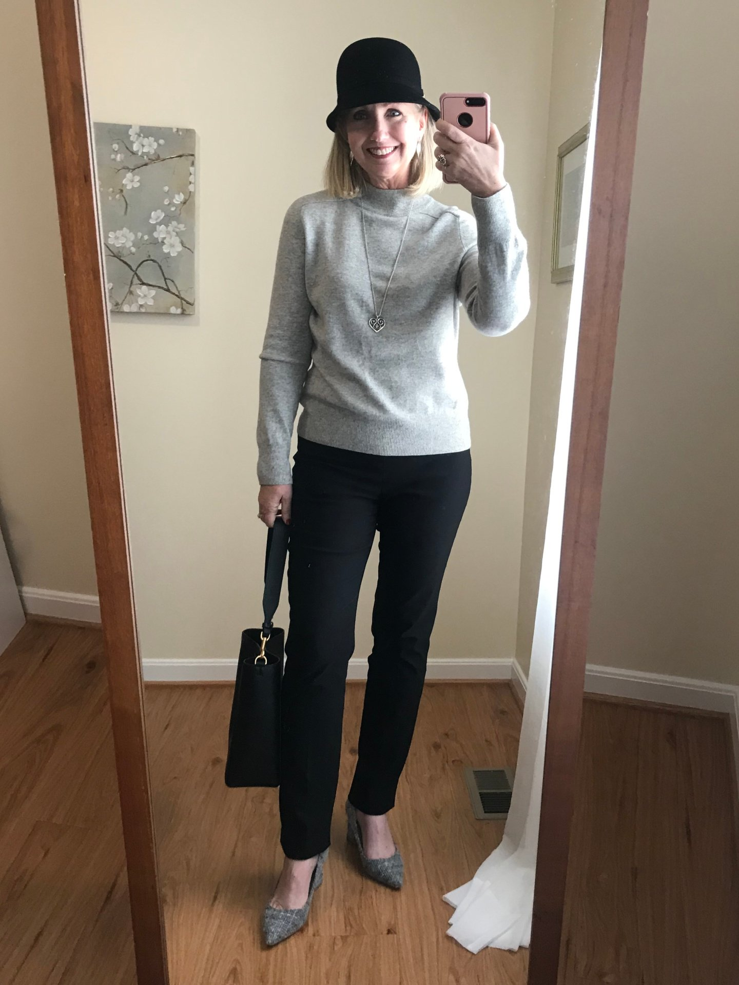 Black pants and light grey sweater
