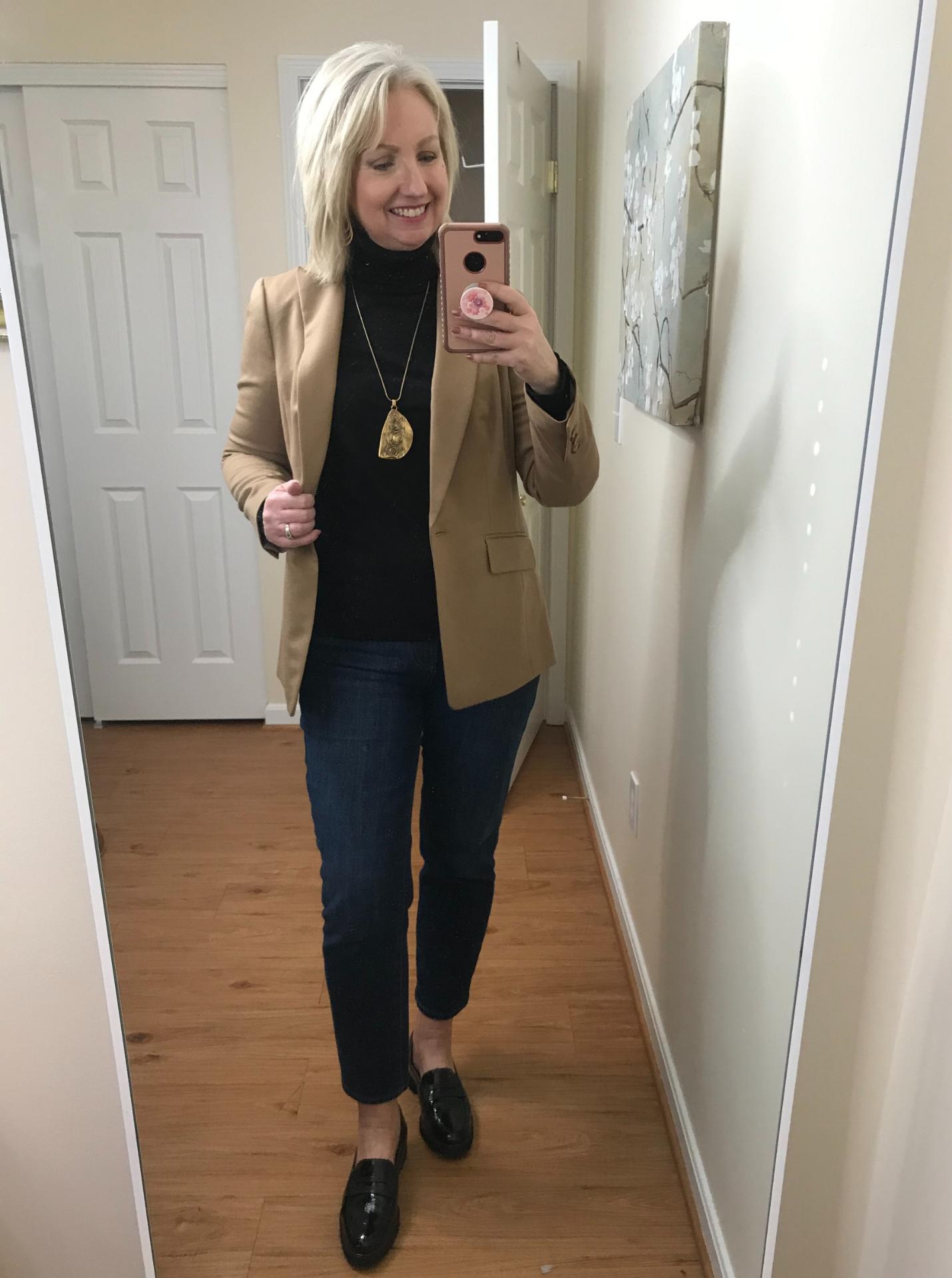 Ankle Jeans Black Turtleneck Untucked Black Loafer Camel Jacket