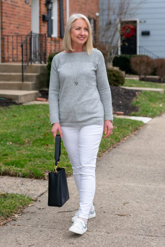 grey sweater with white jeans