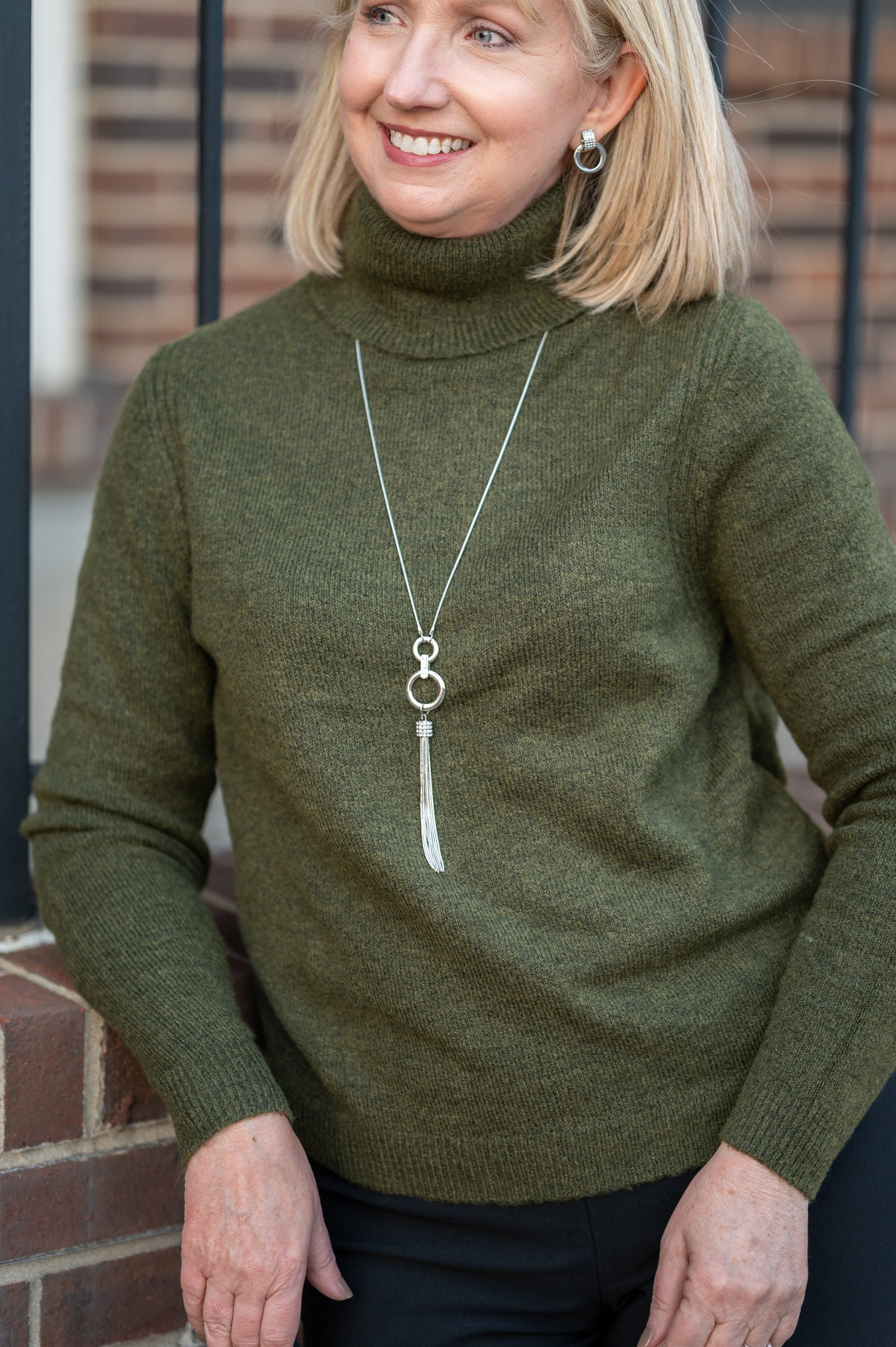 Green Sweater and Jewelry